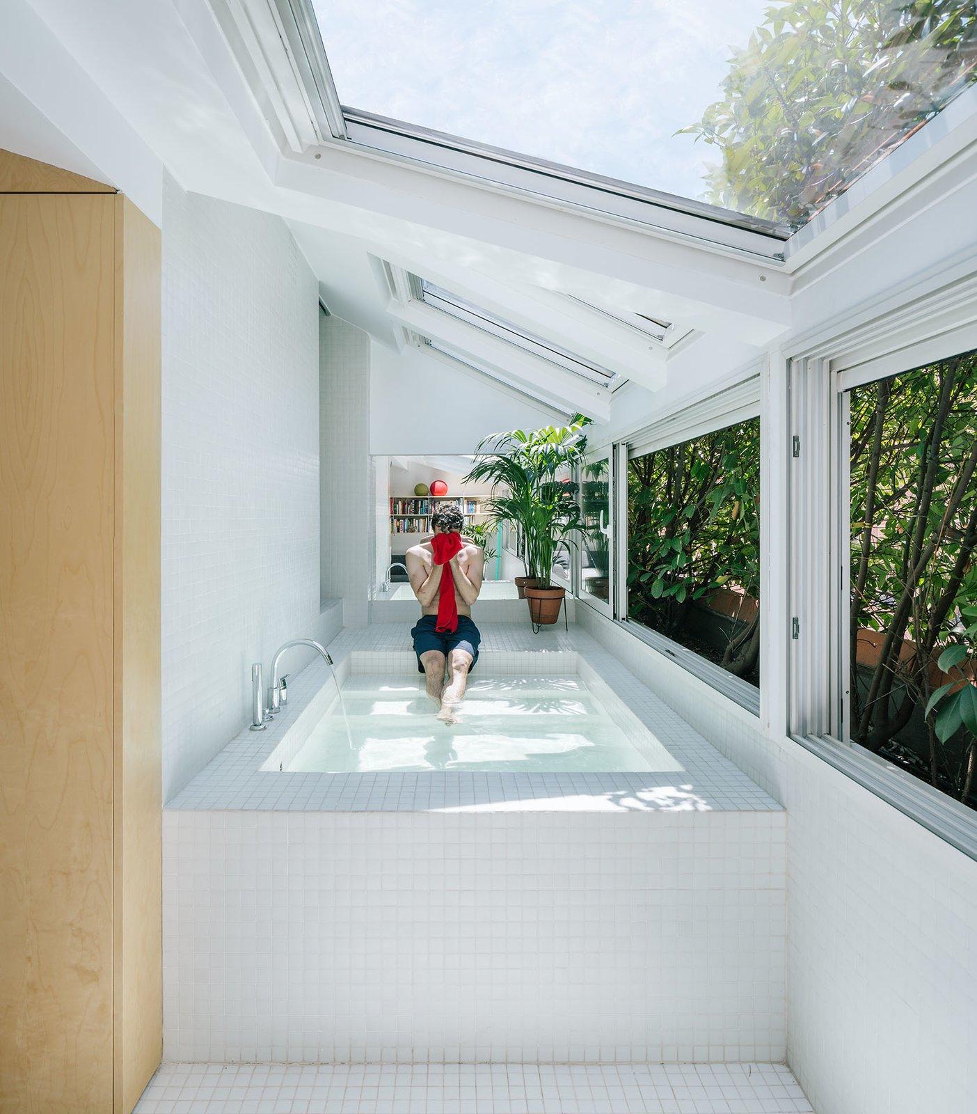 G House bathtub with skylights and windows