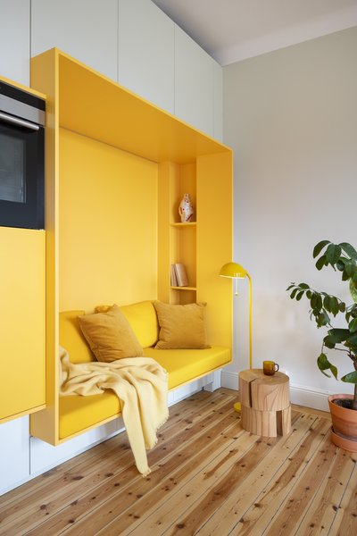 An ingenious small-space solution turns a wall into a sitting area.