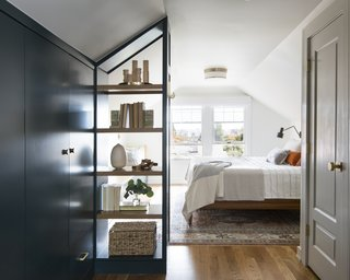 The light-filled master bedroom offers a mix of closed and open storage.