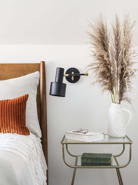 Casework incorporated wall sconces instead of table lamps to save space.
