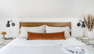 The king-sized bed and end tables are from West Elm.