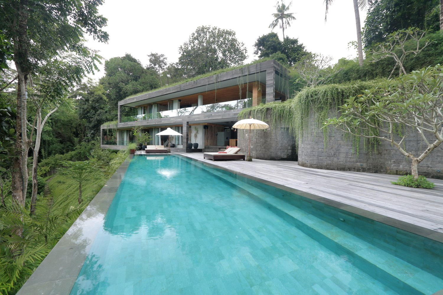 Outdoor, Hardscapes, Back Yard, Trees, Large Pools, Tubs, Shower, Stone Fences, Wall, and Large Patio, Porch, Deck Sited on a steep hill overlooking lush tropical jungle and a river, this private villa is set on different levels that appear as if they are part of the natural landscape. The architecture follows the contours of the land, allowing for in-between spaces and gardens that would otherwise be difficult to enjoy.  Photo 8 of 12 in The 11 Most Influential Buildings of 2018
