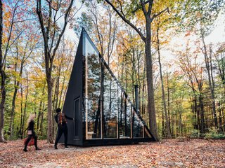 Measuring only 180 square feet, this sleek, prefabricated, off-grid tiny home rotates the classic A-frame cabin structure by 45 degrees to create more usable floor space. Sited in Hudson Valley, the sleek, black cabin by BIG and prefab housing startup Klein is the first model in a series of tiny homes that Klein plans to sell directly to consumers.