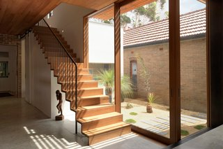 A staircase leads up from the common areas to the bedrooms.