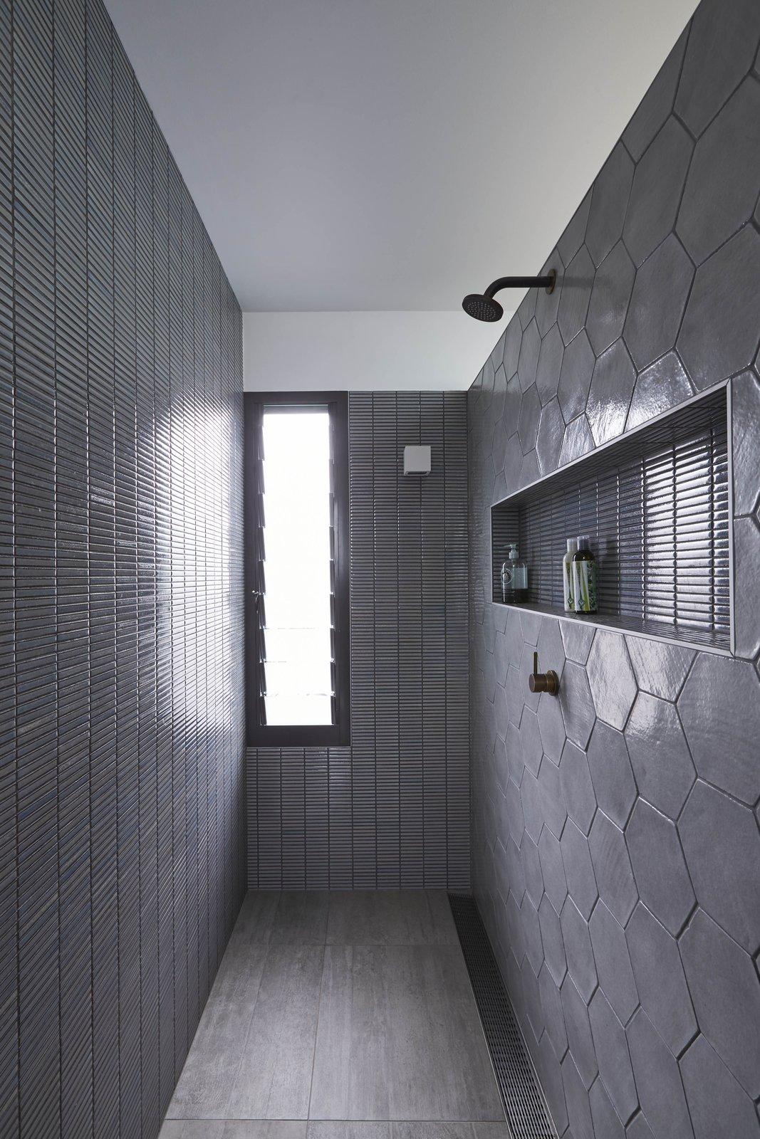 Suntrap House bathroom with gray tile