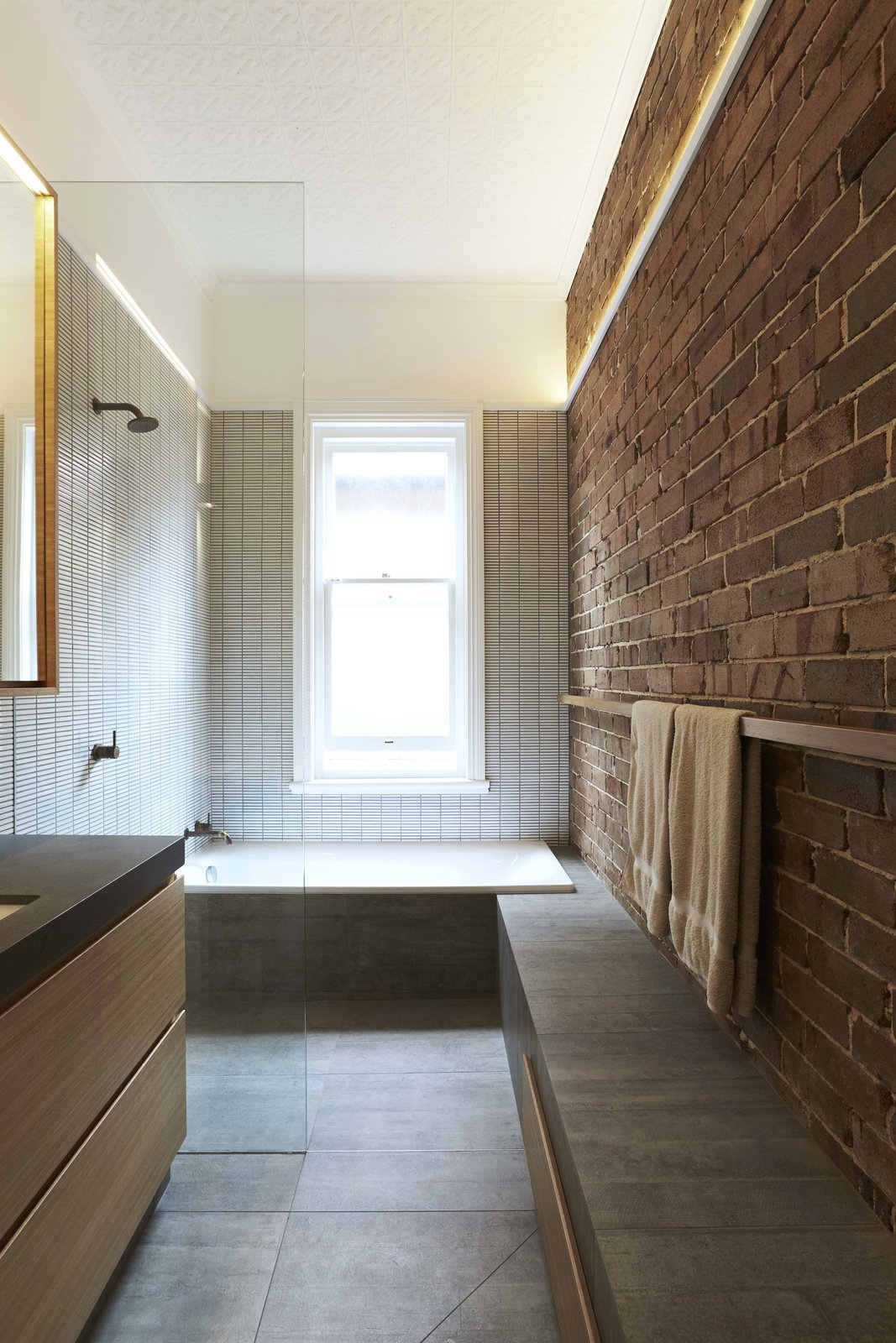 Suntrap House bathroom with exposed brick