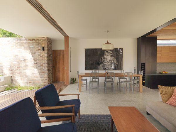 The living room features vintage Greta Jalk Danish armchairs.