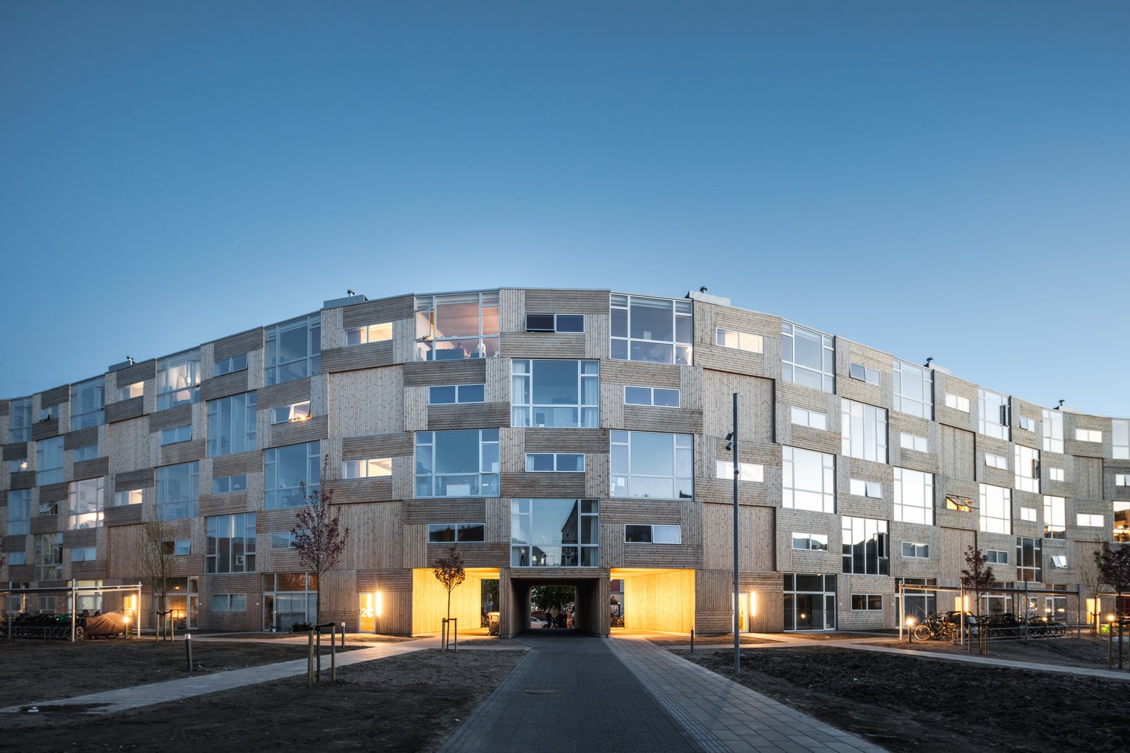 This Curving Prefab Building in Copenhagen Contains 66 Affordable Apartments