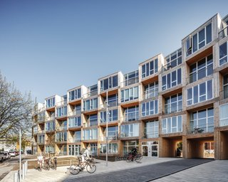 The 73,195-square-foot prefab building hosts 66 new apartments.
