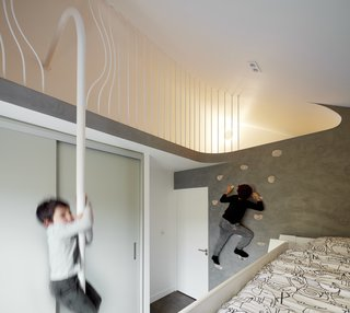 When the directors of London–based Scenario Architecture—husband and wife Ran Ankory and Maya Carni—purchased a Victorian terrace house in London, they sought to renovate, expand, and adapt it to suit the needs of their family of four. The children's bedroom has a climbing wall and a fireman's pole for accessing a special hiding spot in the eave of the historic home.