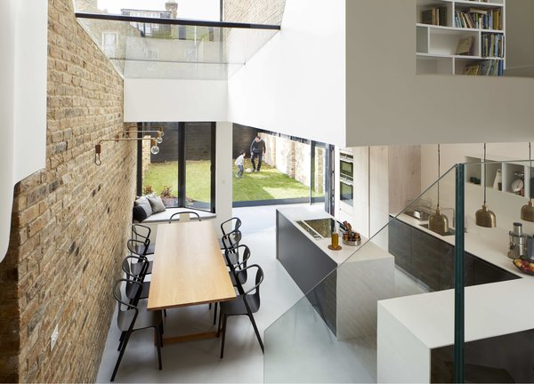 The renovation retained the old brick wall in the dining area and kitchen.