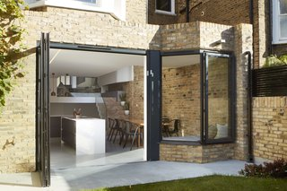 The kitchen door opens wide to improve connectivity to the backyard.