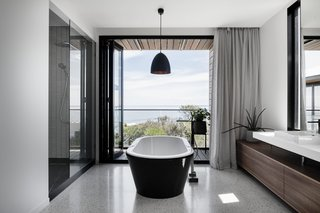 A Kado Lure freestanding tub in the bathroom provides opportunity for a luxurious soak.
