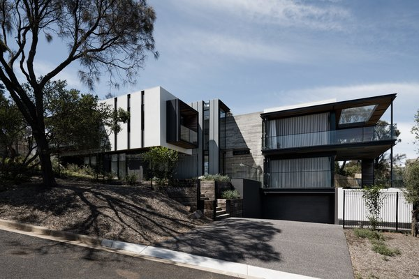 From the street, the house appears as a modest, single-family home in scale with many of the older, post-war homes which exist in the area. But upon entering the house, it's surprisingly expansive.