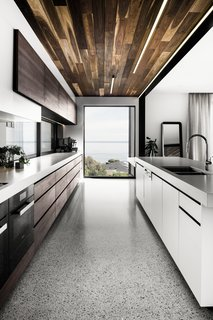 Concrete countertops by Newform Concreting lead the eye towards a large picture window.