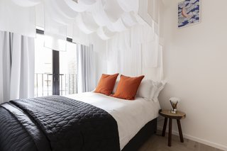 The Loom room features a cozy four-poster bed draped with luxurious, ethereal fabrics.