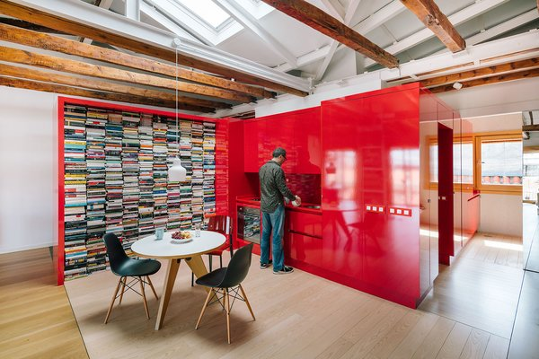The red furniture system contains the kitchen and a large bookshelf.