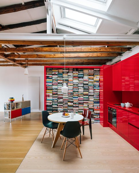 The 48-foot red furniture volume, which is about two feet wide, traverses the interiors, articulating it and adapting to it like a red glove.