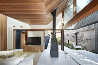A fireplace serves as a boundary between the indoor and outdoor areas.