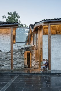 """""""We used a sweeping curvature that rises to create an imaginary space detached from the original projection. Because of the limitation of the original height of the old house, and its badly damaged roof, we added two new floors to the original building,"""" says Zhuang."""