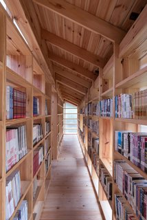 Bookshelves line a corridor.