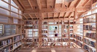 Open, pinewood bookshelves divide the interiors, but don't block views.