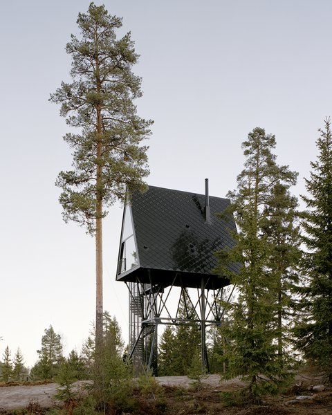 Designed by Espen Surnevik, the PAN Treetop Cabins consist of two A-frame structures elevated into the treetops of a Norwegian forest.