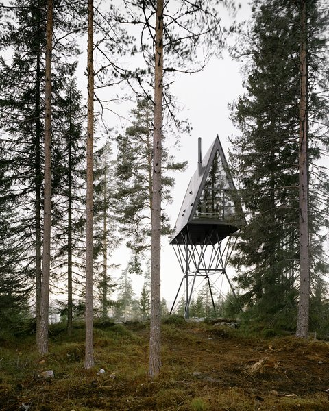Drawing inspiration from fire towers and Nordic folklore, the PAN Treetop Cabins are two 431-square-feet lofted A-frames that sleep six people each. Elevated 26 feet in the air by steel poles and clad in black oxidized zinc and steel, the structures blend into the forested landscape of Eastern Norway.