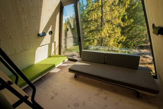 A pull out-green bench can serve as a sleeping area. The energy-efficient cabins face the sun and feature large, glazed facades that draw in light and warmth.