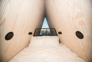 The sleeping loft feels snug, and offers a peek over the treetops.