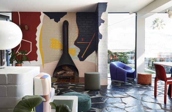 Energetic artwork replaces the typical entertainment unit found in most living rooms.