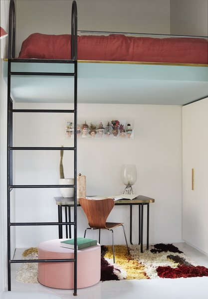 A study area with a lofted bed.