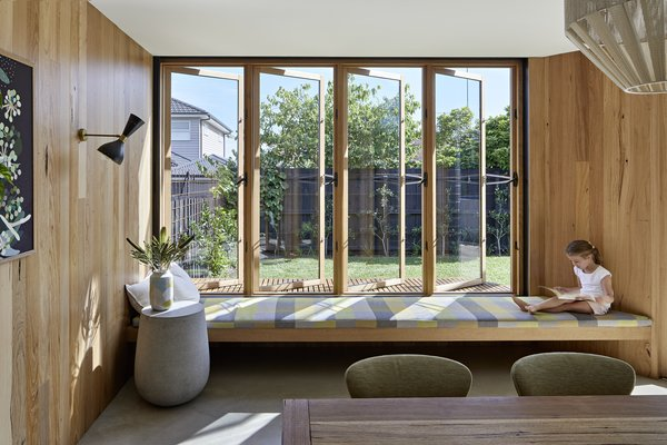 When the casement windows are opened, family members can bask in sunlight while reading a book indoors.