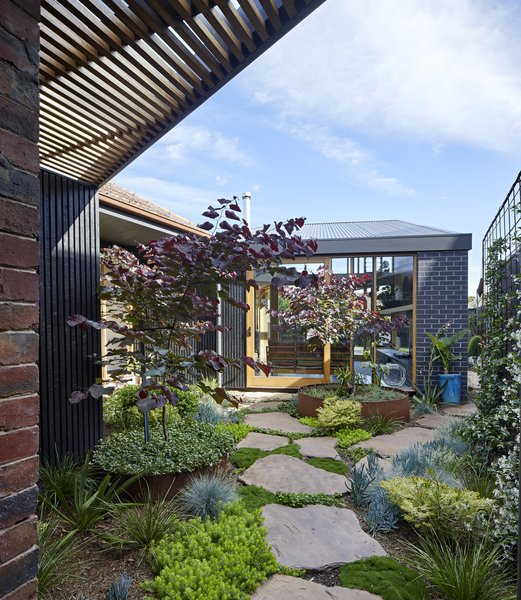 A courtyard creates visual separation between the main house and the addition.