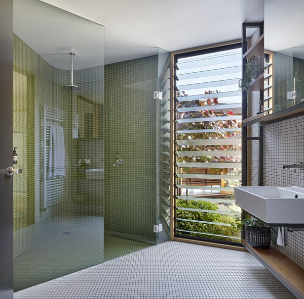 A bathroom with a corner shower.