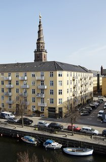The holiday rental by Tina Seidenfaden Busck is located in the charming Christianshavn district of old Copenhagen and has uninterrupted views overlooking the canal and the spire of Our Savior's Church.