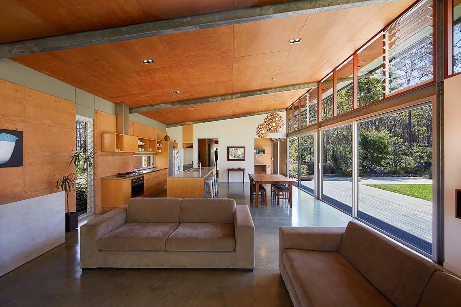 Bush House living room with rammed earth walls
