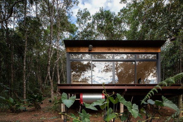 The top priorities for Chalet M—a small, plywood cabin in the suburban area of São Lourenço da Serra in São Paulo, Brazil—were to ensure the lightest possible footprint on its forest site, and to maximize the experience of being one with nature for its owners.