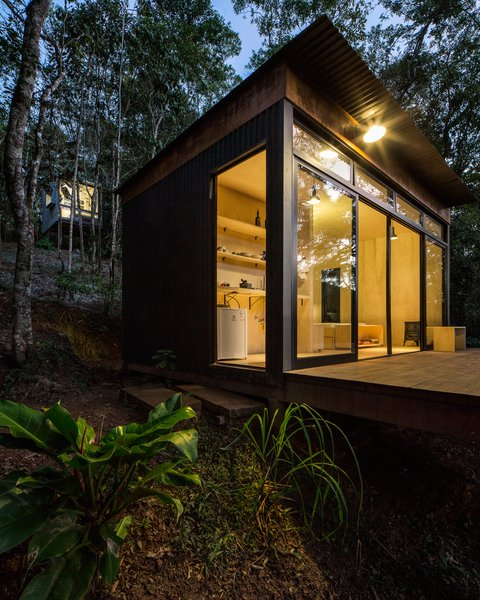 The shell of the cabin was constructed with thin sections of hardwood, then coated with plain OSB plywood and a Tyvek air and water barrier. Metallic corrugated sheets form the outer layer.
