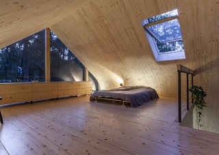 A skylight in the bedroom brings in daylight and offers a view of the stars.