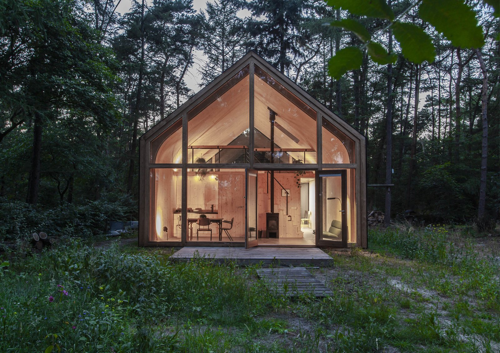 Exterior, Cabin Building Type, Wood Siding Material, Gable RoofLine, and Metal Roof Material The back of the volume acts as a wall that separates the living spaces from the sculpture studio.�