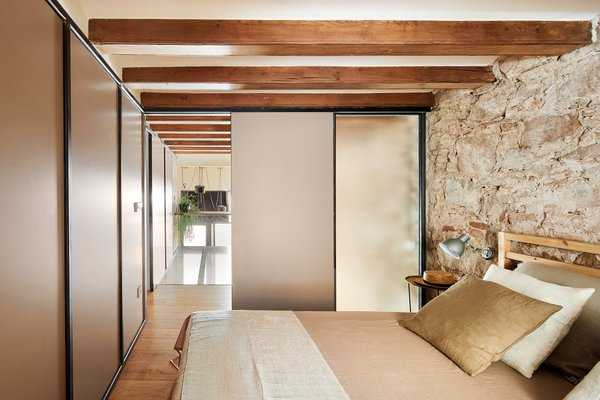 Oak wood features in the parquet floor, the attic support structure, and some of the furniture.