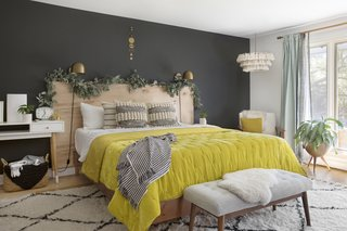 A cheerful mustard duvet brightens up the master bedroom.
