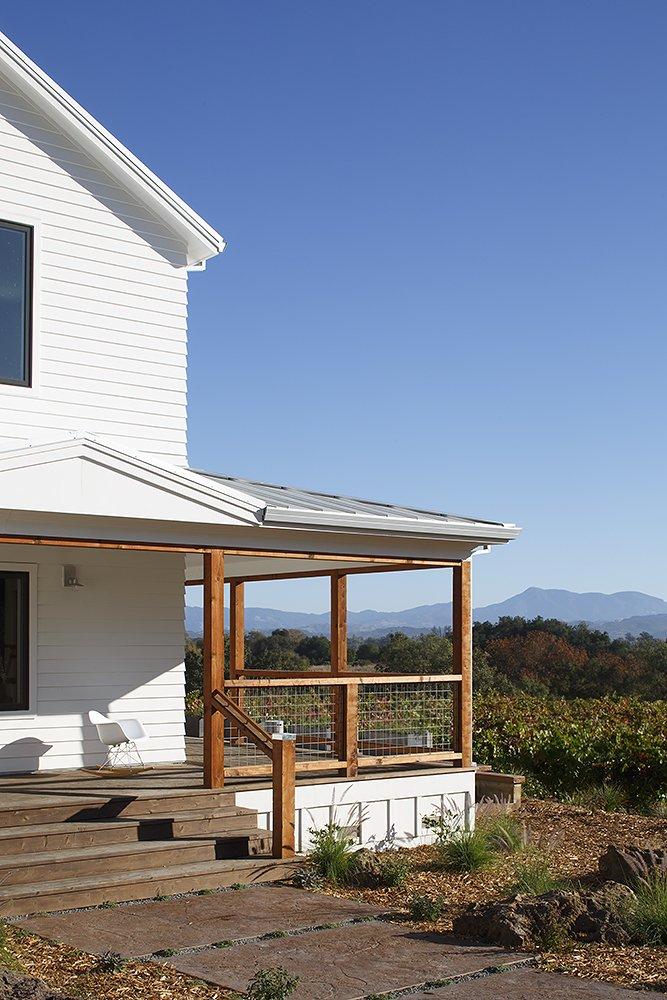 Outdoor Wrap around porch   Modern Vineyard Farmhouse by Amy A. Alper, Architect