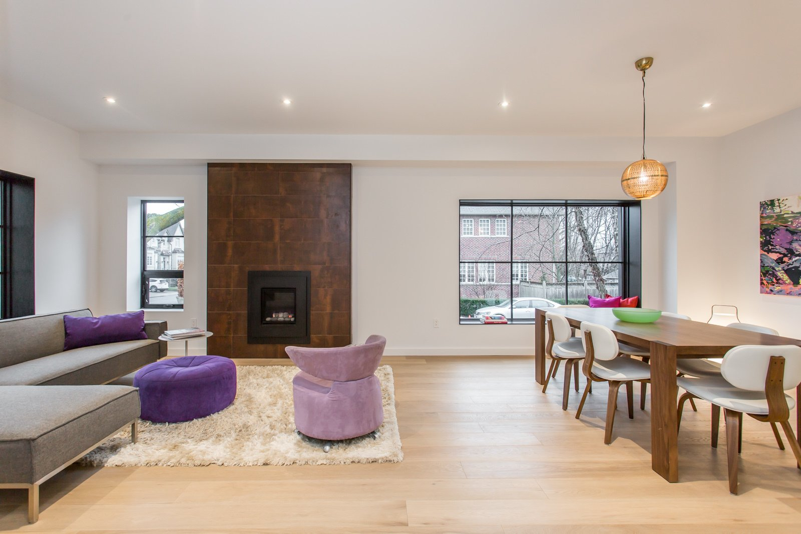 Living room and dining room benefit from big window openings that bring light in.  Manor Road house