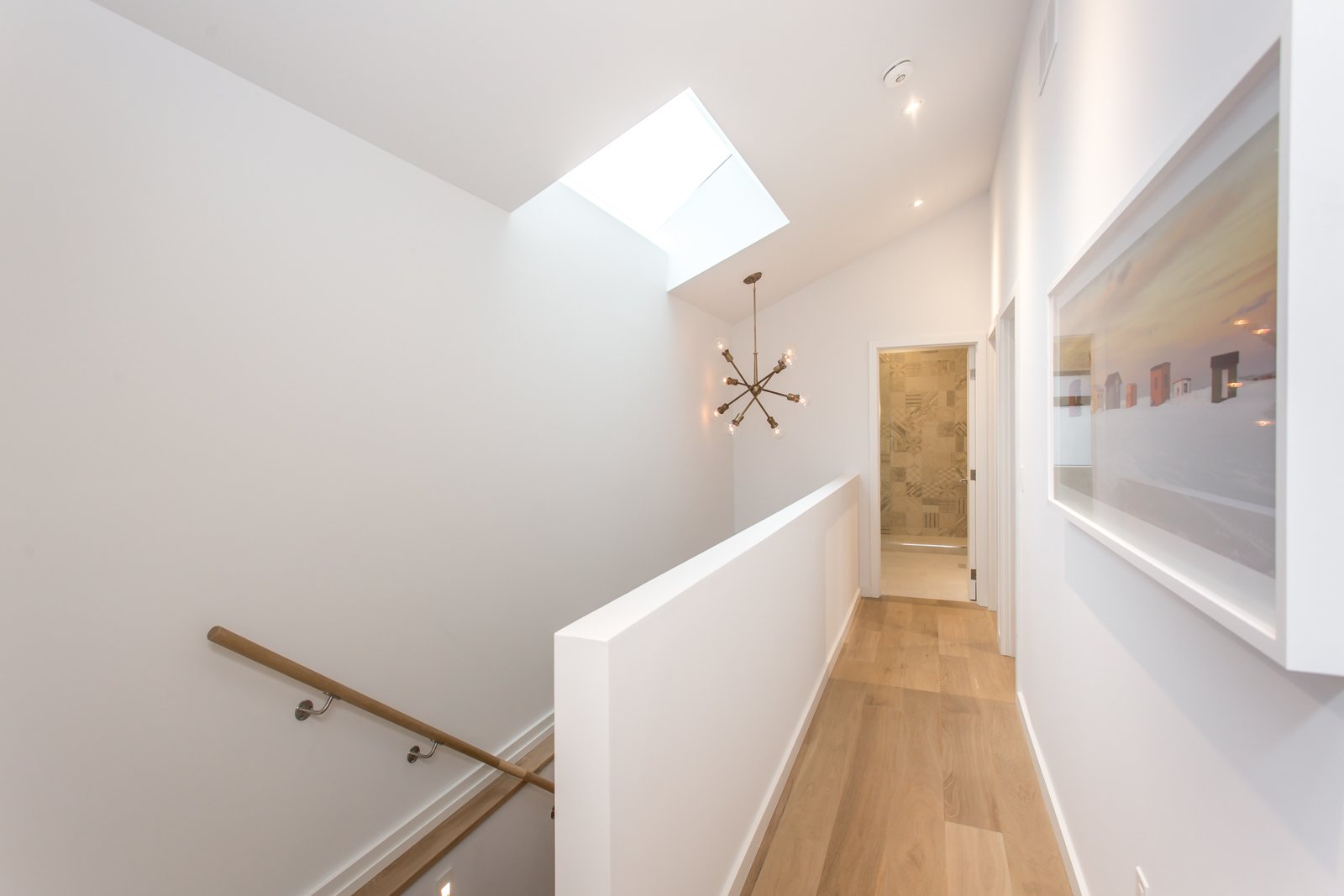 Staircase with skylight.  Manor Road house