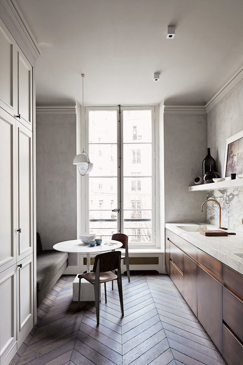 Kitchen, White, Wood, Dark Hardwood, Marble, Marble, Ceiling, Pendant, and Drop In Simply Paris The Paris kitchen of architect  Joseph Dirand.  Kitchen Drop In Pendant Marble Wood Photos from Kitchen