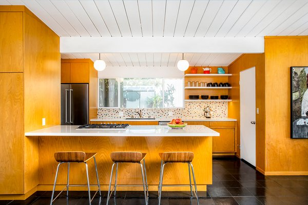New Custom Cabinetry and Wall Paneling Retain the Warmth and Feel Original to this Eichler Home
