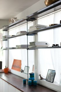 The couple fabricated the shelving themselves.