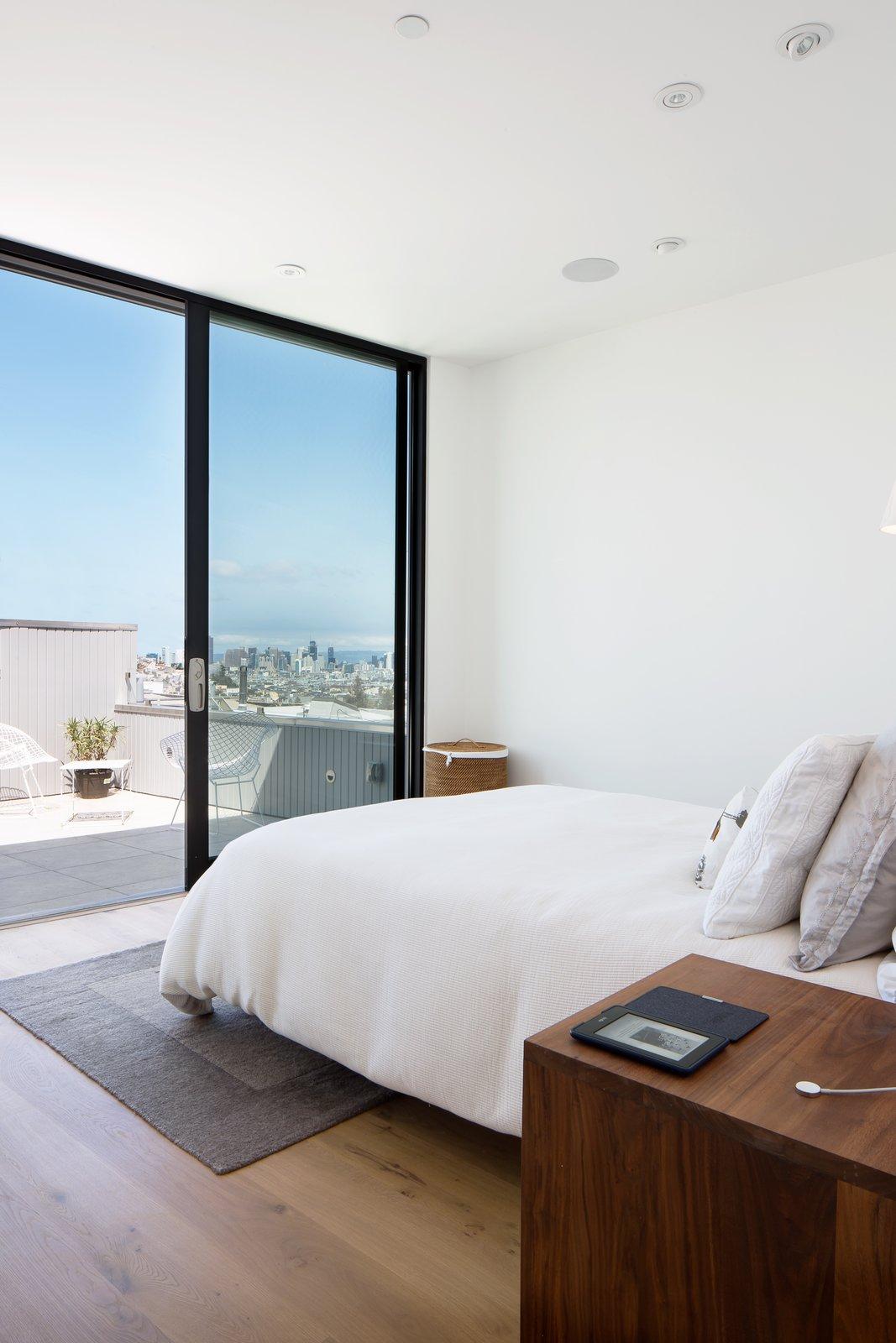 Bedroom, Bed, and Medium Hardwood Floor Master bedroom  27th Street - Noe Valley by patrick perez/designpad architecture